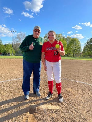 New Philadelphia's Julia Miller was named the Manor Restaurant Player of the Game and was honored by Big Time Sports boss Charlie Jones after her 21-strikeout, no-hit performance Wednesday night.