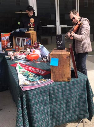 Local residents Jeff and Nancy Orr had memorabilia and craft items at their vendor stand on Main Street.