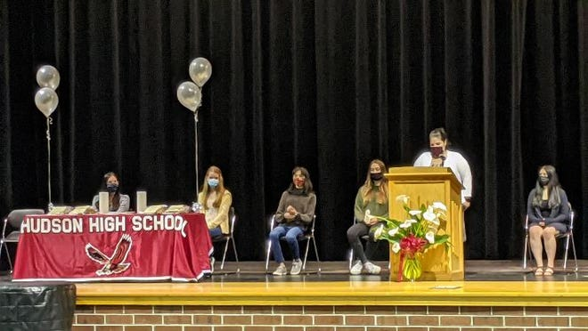Hudson High School selected seniors and juniors were initiated into the William D. Coolidge chapter of  the National Honor Society on May 7 at the school auditorium. Among those presiding were, from left, Anna Helbe; Maia Nicolosi; Olivia Foo; Madison Kiley; Kerry Bartlett, advisor to the Junior Honor Society; and Emily Figueiredo.