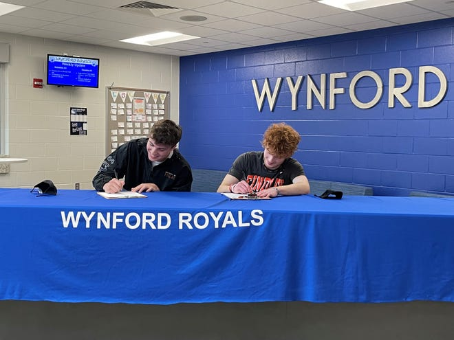Wynford's Dustin Brady and Lucas Hackworth sign their letters of intent to play football at the University of Findlay.