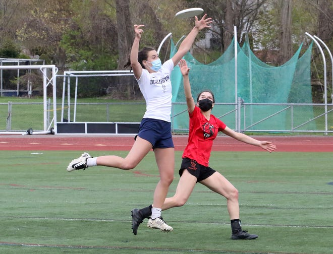 Burlington defender Ariel Felcan breaks up a pass intended for CVU's Jessica Klein during the Seahorses' 15-5 Ultimate over the Redhawks on Wednesday night at BHS.