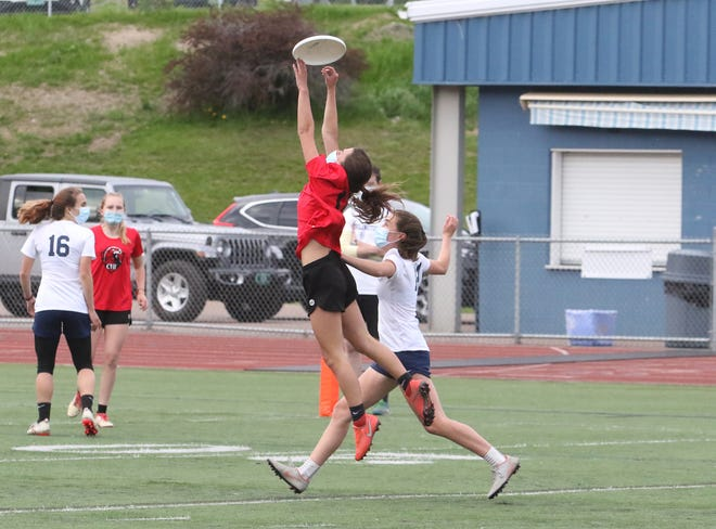 CVU senior Makayla Urie makes a great fingertip catch during the Redhawks' 15-5 road loss to Burlington on Wednesday night at BHS.
