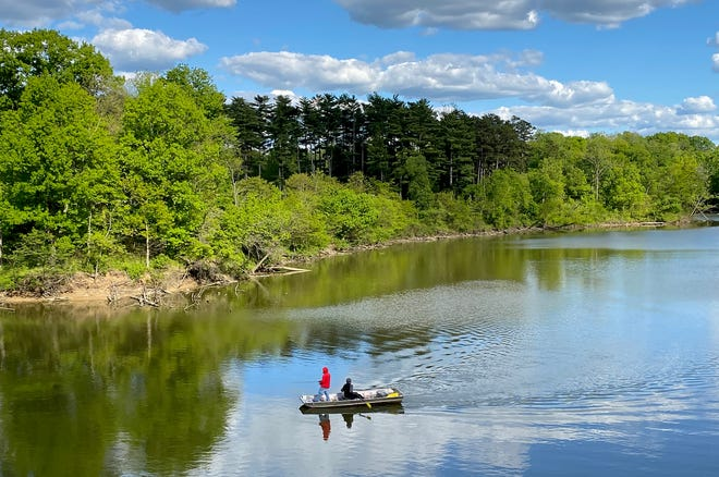 People fish at Winton Lake at Winton Woods Park Wednesday, May 13, 2021.
