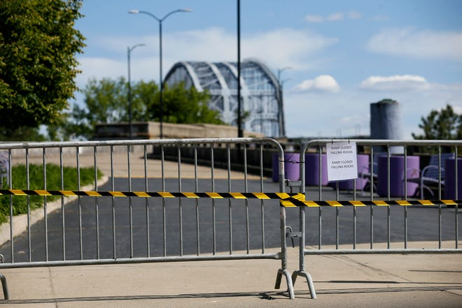 The Purple People Bridge, spanning from downtown Cincinnati to Newport, Ky., is closed for repair after reports of falling concrete, as seen on Thursday, May 13, 2021.
