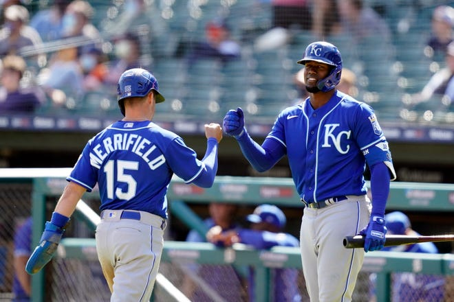 Kansas City Royals' Whit Merrifield (15) is greeted by Jorge Soler after scoring during the ninth inning of a baseball game against the Detroit Tigers, Thursday, May 13, 2021, in Detroit