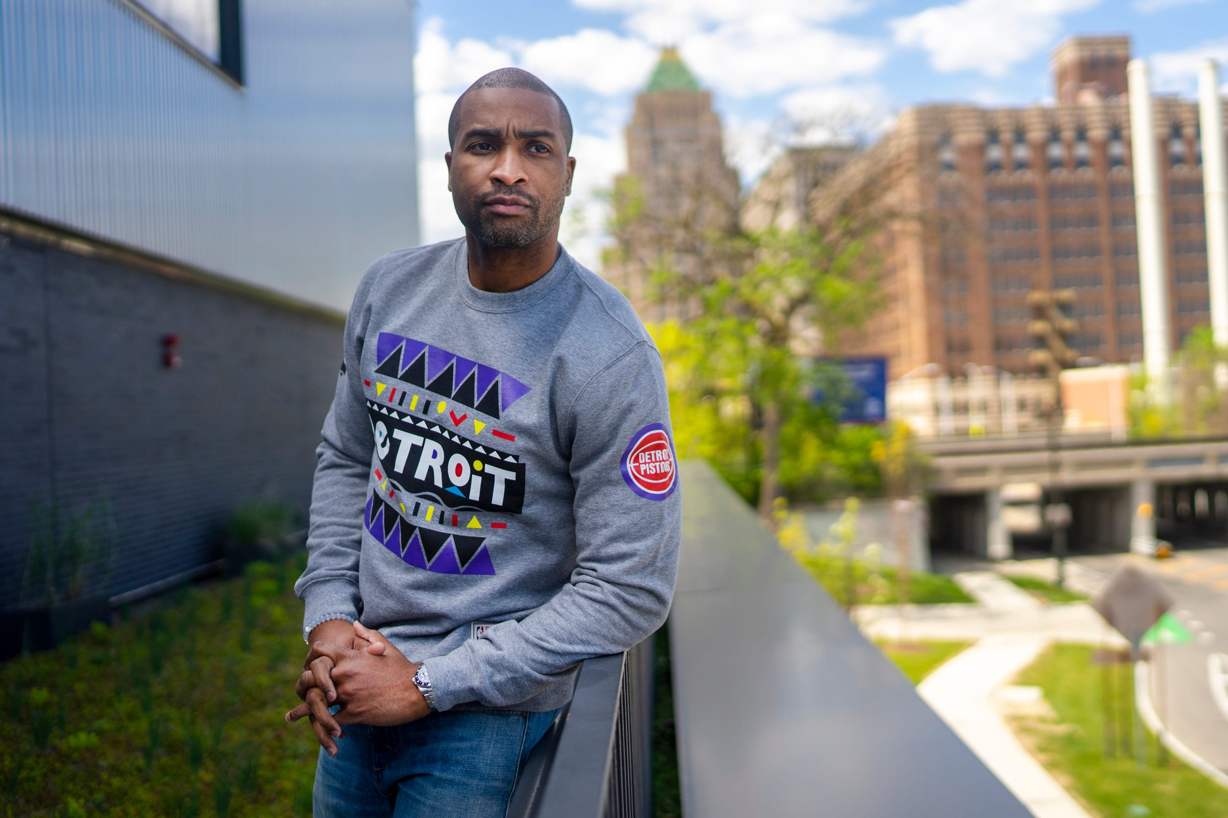 Will Bradford poses for a portrait wearing a sweater from the limited edition Pistons x Martin Merchandise Line at the Pistons Performance Center on Thursday, May 13, 2021, in Detroit.