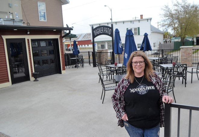 Carisa Deheck stands on the deck of the new patio at her Wooden Shoe Bar & Grill, which has nearly completed a major expansion and renovation project, which was supported by a grant from the Wisconsin Department of Economic Development.