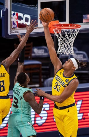 Indiana Pacers center Myles Turner (33) blocks a shot by Charlotte Hornets guard Terry Rozier (3) during the second half of an NBA basketball game in Indianapolis, Friday, April 2, 2021. (AP Photo/Doug McSchooler)