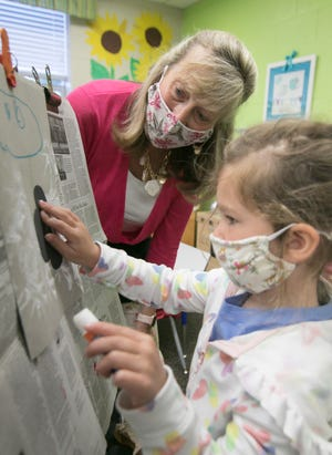 Lisa Guise, director of First Steps Preschool in Brighton, watches 4-year-old Mia Greenwold work on an art project Thursday, May 13, 2021. Guise will retire next month after 30 years with the preschool.