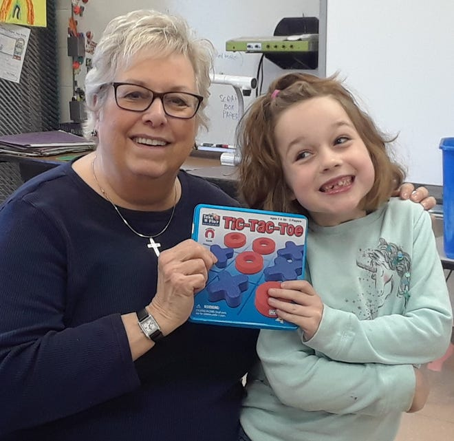 Big Sister Darla Miller and her lunch buddy Izzy, who were matched through Mentor Livingston's bi-weekly lunch buddy program.