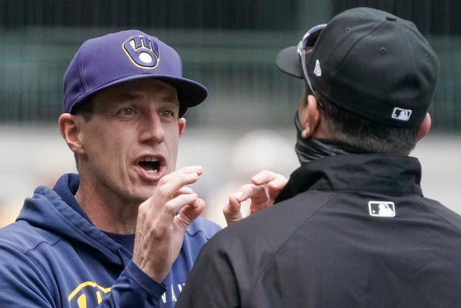 Brewers manager Craig Counsell argues a call with umpire Jim Reynolds during the third inning Thursday. Counsell as ejected from the game.