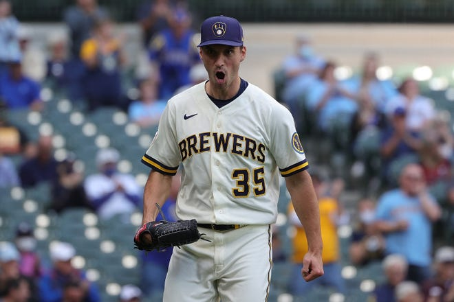 Brent Suter is pleased with the result of the play at home plate in the seventh inning Thursday.
