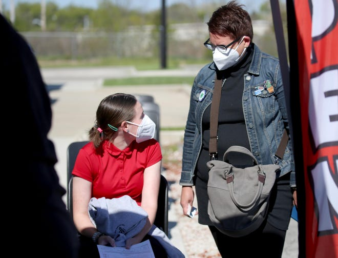 Simone Steeno, 14, left, talks with her mother, Heidi Steeno of Milwaukee, before Simone gets her COVID-19 vaccine.