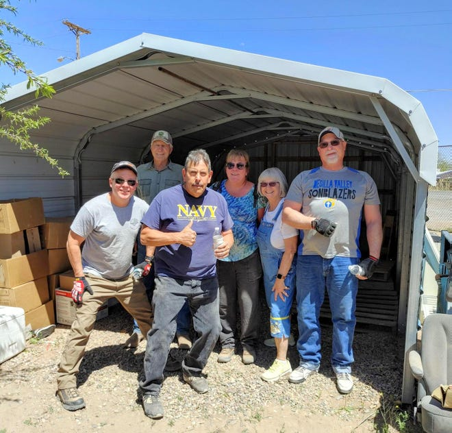 The Knights of Columbus of Holy Family Catholic Church provided some much-needed help to the St. Vincent de Paul recently. From left are Dave Loyer, Ed Remondini, Javier Villalva, Susan Loyer, Cheryl Lenhardt (St. Vincent de Paul Thrift Store) and John Zunich.