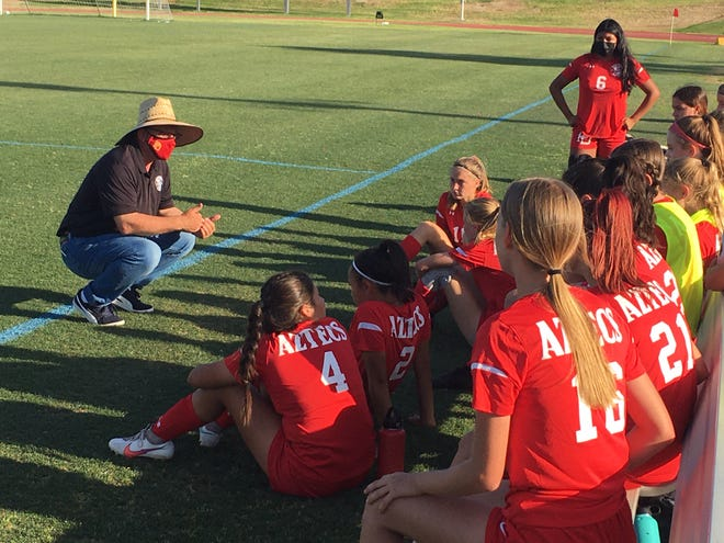 Palm Desert girls' soccer Chris Keuilian talks to his troops during halftime of Wednesday's 3-2 overtime playoff win over Mayfield (Pasadena).