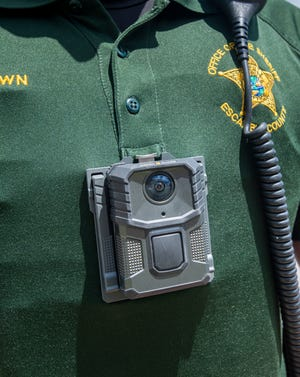 Sgt. David Brown wears one of the new body cameras at the Escambia County Sheriff's Office in Pensacola on Thursday, May 13, 2021.
