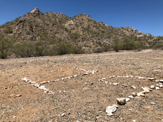 A week after one Phoenix hiker reported an unofficial tribute to the Granite Mountain Hotshots missing, a new one took its place.