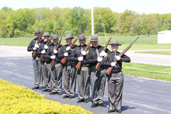 Members of the Ottawa County Sheriff Honor Guard presented a 21-Gun Salute at a police memorial service on Thursday.