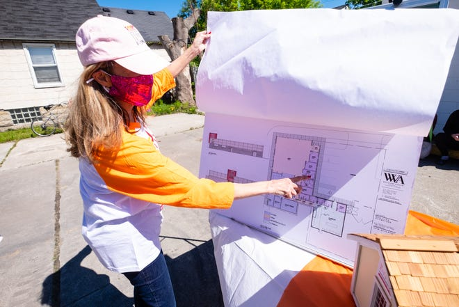 Mid City Nutrition Executive Director Alice Rieves talks about the plans for its new building at a ground-breaking ceremony Wednesday, May 12, 2021, in Port Huron. Rieves said they hope to be in the building by Christmas.