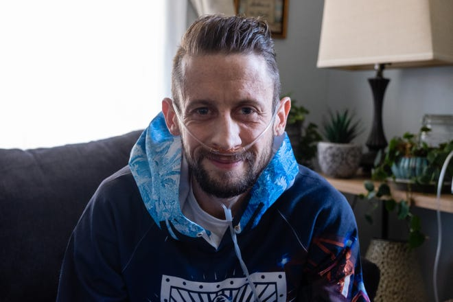Kyle Bailey poses for a portrait Wednesday, May 12, 2021, in his family's Port Huron home. At the time, his body had begun to reject his donated lungs, and he hoped to re-enlist for another transplant. Bailey died Sunday, Sept. 5, 2021.