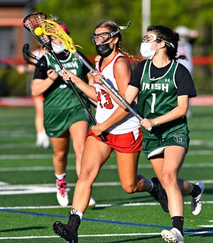 York Catholic's Olivia Staples, seen here at right in a file photo, had five goals and three assists on Thursday in YC's victory over Lampeter-Strasburg.