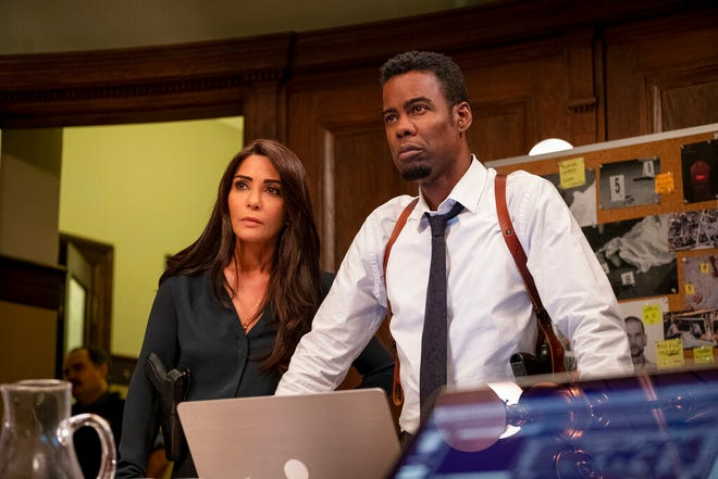 """Marisol Nichols, left, and Chris Rock star in """"Spiral: From the Book of Saw."""" The movie opens Friday at Regal West Manchester, Queensgate Movies 13 and Hanover Movies 16."""