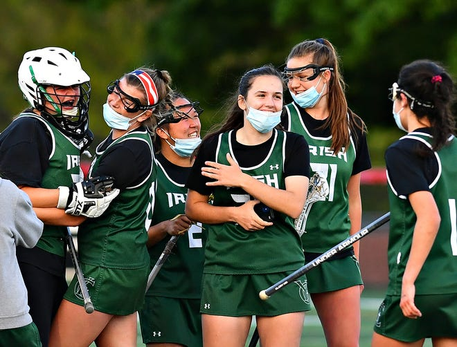 York Catholic celebrates a 16-6 win during girls' lacrosse action at Susquehannock High School in Shrewsbury Township, Wednesday, May 12, 2021. Dawn J. Sagert photo