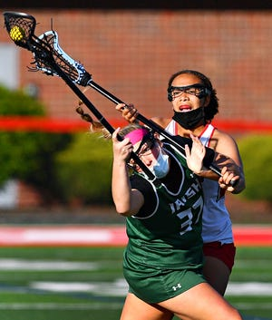 York Catholic's Ella Linthicum, seen here at front in a file photo, had three goals and six assists on Thursday against West York.