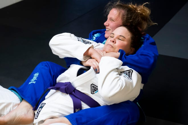 Brittany Inkrote tries to escape as Lauren Huncher holds her in a rear naked choke during a session at York Brazilian Jiu-Jitsu on Thursday, May 6, 2021.