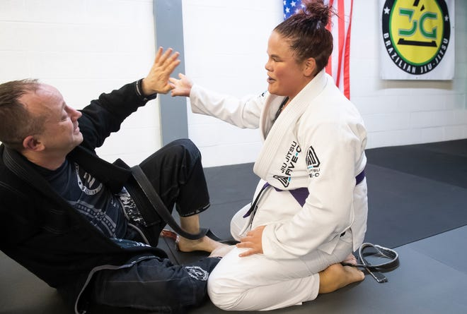 Brittany Inkrote high-fives Gregg Anderson after grappling together at York Brazilian Jiu-Jitsu on Thursday, May 6, 2021. Anderson, a second-degree black belt, is an instructor and co-owner of York BJJ and is also a lieutenant with the Northern Regional Police Department.