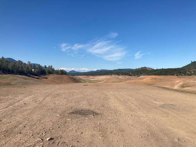 Water in Lake Shasta, as seen Wednesday, May 12, 2021, has receded far into the distance in the Jones Valley area of Lake Shasta during the drought. Shasta County was among the counties included in Gov. Gavin Newsom's drought emergency declared that week.