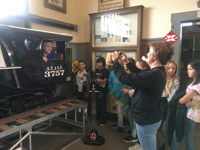Students from Water Valley Elementary School climb aboard a train inside the Railway Museum in San Angelo.