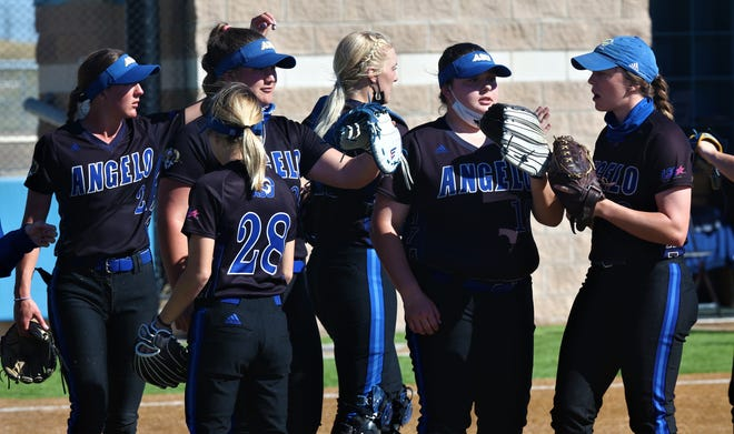 The Angelo State University softball team celebrates with pitcher Makayla Corbin, second from the far right, after a win earlier in the 2021 season.
