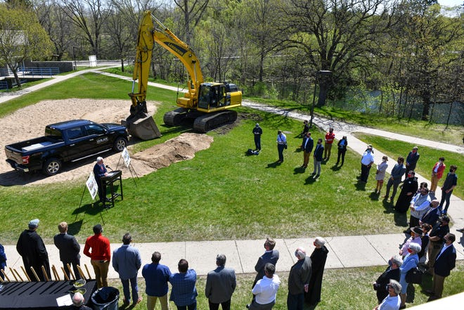 People gather for a ceremony on the site of the new Saint Elizabeth Seton Village project Wednesday, May 12, 2021, at St. John's University in Collegeville.