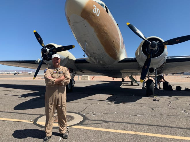 Pilot Chris Schaich with a C-47 transport plane from WWII