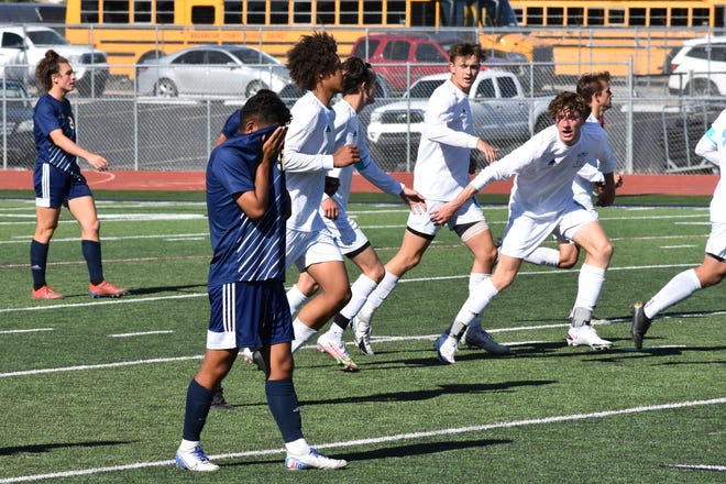 Snow Canyon players on the field during the 4A state quarterfinals matchup in St. George on Wednesday. The No. 4Warriors were upset by No. 5Sky View 5-0, while No. 11 Ridgeline upset its second Region 9 team in as many weeks bybeating the No. 3 Flyers 2-0.
