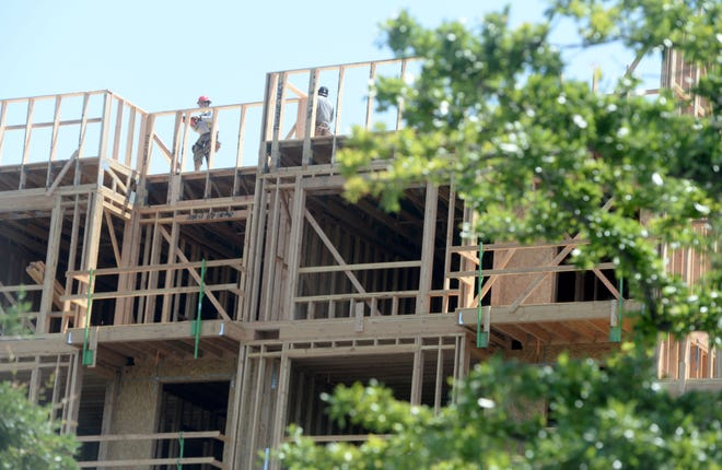 Workers build a mixed-use development at 299 E. Thousand Oaks Blvd, Thousand Oaks on Wednesday, May 12, 2021. The development will feature 142 rental apartments and more than 10,000 square feet of commercial space.