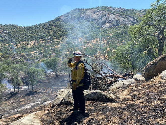 Wildland firefighters are battling the 70-acre Buzzard Fire in the northeast Tulare County. The blaze was 75% contained Thursday morning.