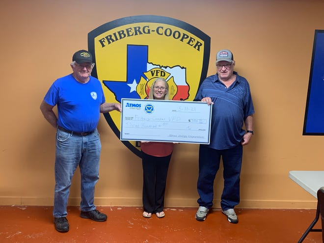Pictured from left are Assistant Fire Chief Terry Hanks, Mayor of Cashion Debbie Carr, and Cashion City Councilor Steve Carr.