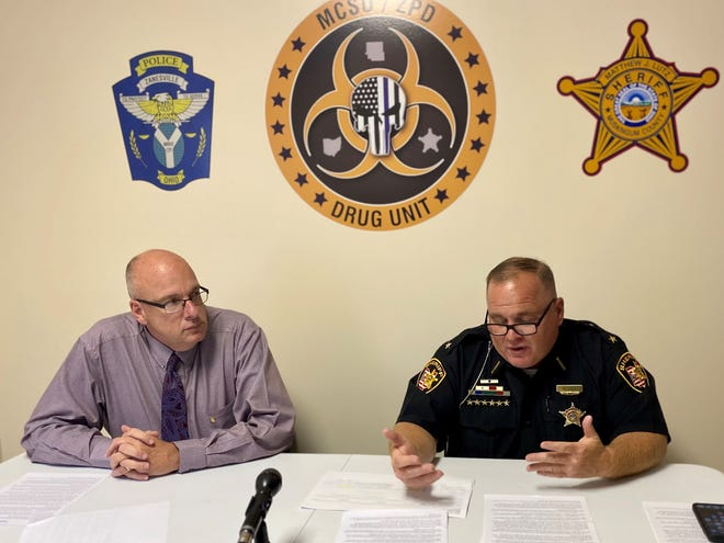 Zanesville Police Chief Tony Coury, left, and Muskingum County Sheriff Matt Lutz held a press conference Thursday to say they have traced fatal drug overdoses back to the individuals who sold the drugs. They said three dealers and their associates have been charged.