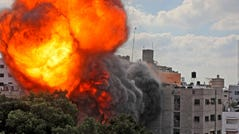 A picture taken Thursday shows a ball of fire engulfing the Al-Walid building, which was destroyed in an Israeli airstrike on Gaza city early in the morning. An Israeli strike destroyed another multi-story building in Gaza City the previous night, as the Jewish state continued its heavy bombardment of the Palestinian enclave.