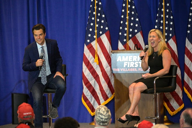 Rep. Matt Gaetz, R-Fla., left, and Rep. Marjorie Taylor Greene, R-Ga., address attendees during a rally, Friday, May 7, 2021, in The Villages, Fla.