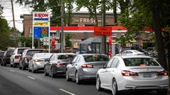 Motorists line up at an Exxon station selling gas at $3.29 per gallon soon after its fuel supply was replenished in Charlotte, N.C. on May 12, 2021. Most stations in the area along I-95 were without fuel on Wednesday following the Colonial Pipeline hack.