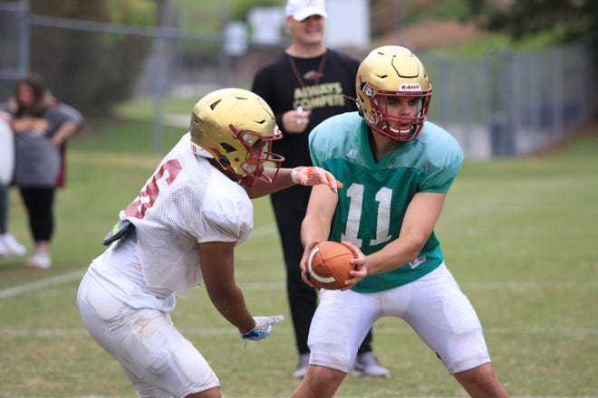 Dylan Lonergan runs a read option play during spring practice at Brookwood last week.