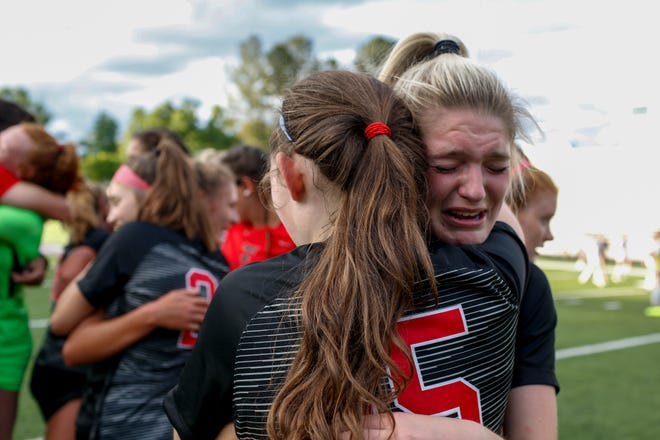 The North Oconee High School varsity soccer team emotionally celebrates their 3-2 state championship win Thursday against Marist. (Rebecca Wright for the Athens Banner-Herald)