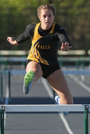 Cuyahoga Falls Ellie Brustoski clears the last hurdle on her way to a first place finish in the girls 300 meter hurdles at the Suburban League National Conference track meet at Nordonia High School on Thursday May 13, 2021.