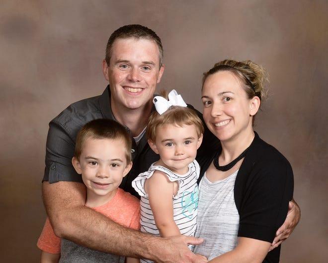 Julie Braden and her husband, Alex, are seen with children Logan and Makenzie. The Bradens have a third child, Landon.