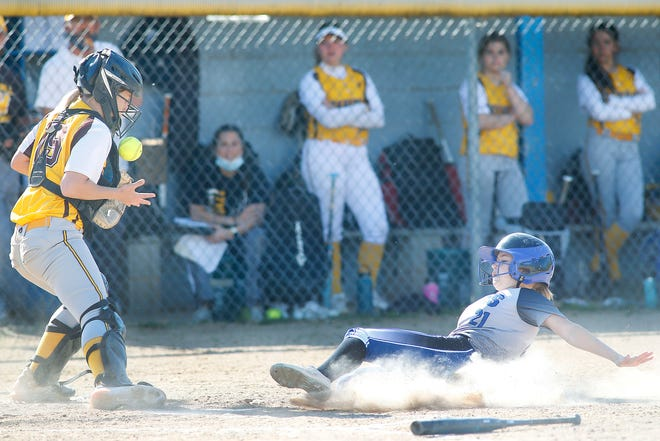 Northwestern High School's Avery Garver scores as Waynedale's Lacey Walters fields the ball during a Div. III sectional final game Thursday, May 13, 2021.