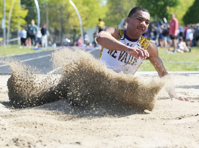 Nevada's Jacob Joe lands during the boys' long jump in the Class 3A state qualifying track meet May 13 Cub Stadium in Nevada. Joe won the event to automatically qualify for state.