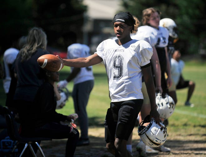 Kaleb Jackson is photographed at Evans High School in between drills during spring practice. The 2022 quarterback announced his commitment to Albany State University on Tuesday. [WYNSTON WILCOX/THE AUGUSTA CHRONICLE]